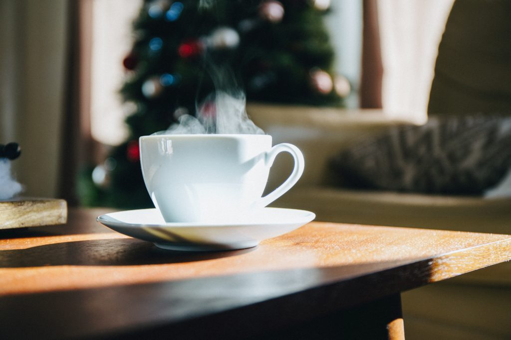 steaming-coffee-on-table-with-holiday-decor